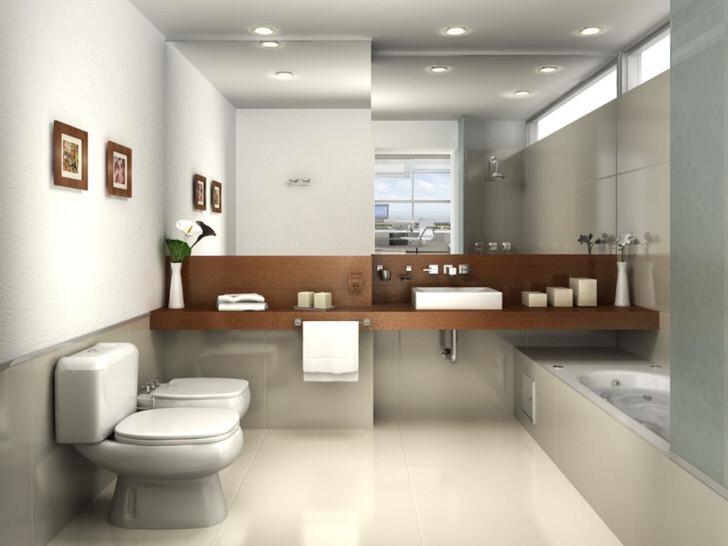 Ванная в стиле минимализм оформлена в светло-серых оттенках. Взгляд притягивает большое зеркало, которое занимает всю стену над умывальником.