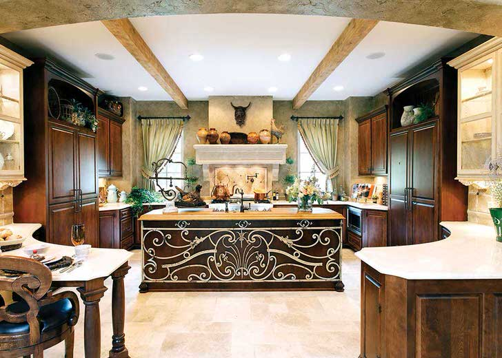 Благородный цвет венге делает кухню королевской. Рабочую поверхность центрального стола украшена шикарным, витиеватым рисунком.