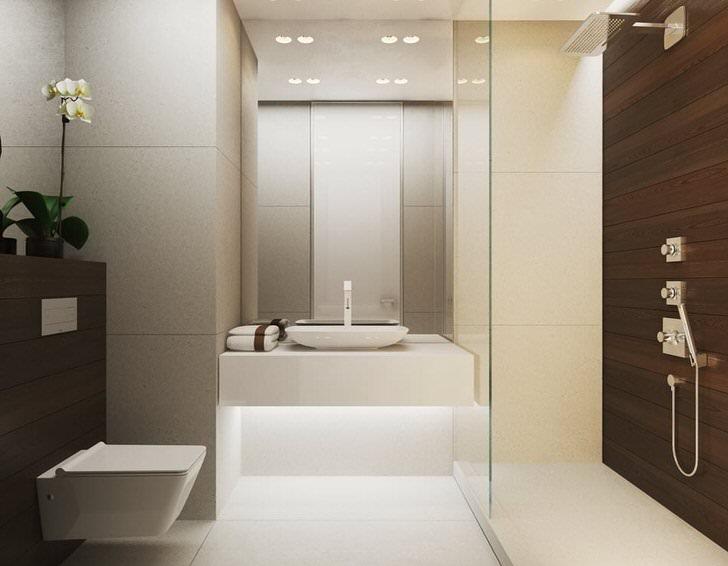 Малогабаритная ванная комната в стиле минимализм оборудована большой душевой кабиной. Стеклянная перегородка визуально расширяет пространство.