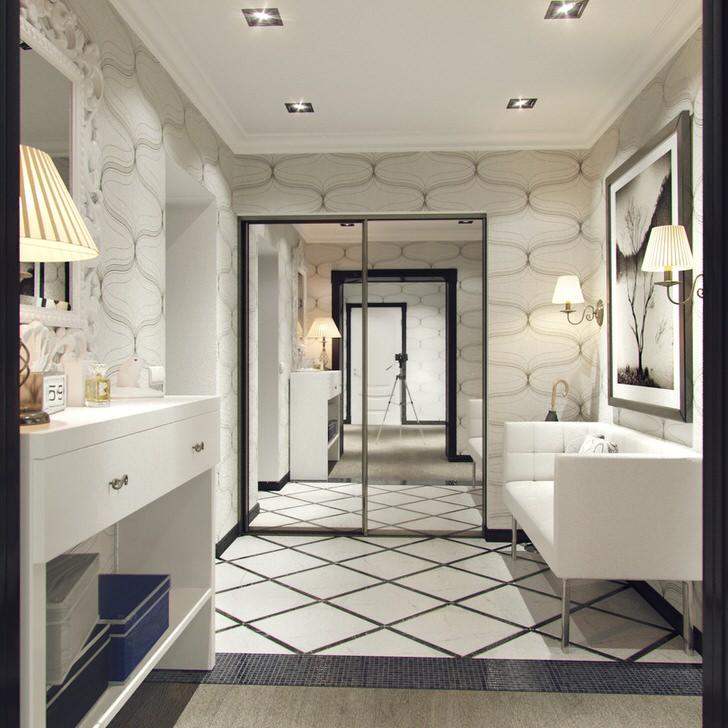 Четкие геометрические формы мебели подчеркнуты интересным рисунком отделки стен. Большой зеркальный шкаф-купе - незаменимая вещь в интерьере.